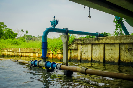 Outdoor view of pipeline on the Chao Phraya river. Thailand, Bangkok Imagens