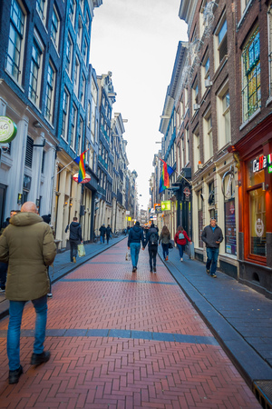 AMSTERDAM, NETHERLANDS, MARCH, 10 2018:Outdoor view of unidentified people walking in the streets of the city at summer time