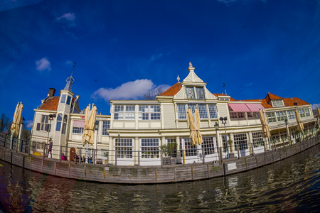 AMSTERDAM, NETHERLANDS, MARCH, 10 2018: Outdoor view of Canal cruise museum tour building bar and restaurant