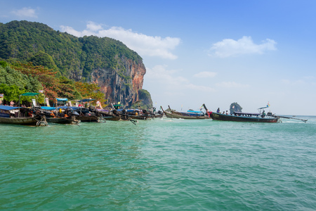 AO NANG, THAILAND - MARCH 23, 2018: Outdoor view of many long tail boat in Thailand, standing on Chicken island in a gorgeous sunny day and turquoise water