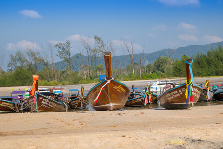 AO NANG, THAILAND - MARCH 05, 2018: Beautiful outdoor view of Fishing thai boats in a row at the shore of Po-da island, Krabi Province, Andaman Sea, South of Thailand