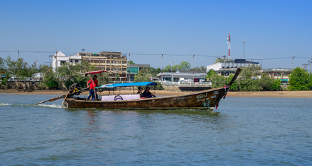 AO NANG, THAILAND - FEBRUARY 19, 2018: Long tail fishing boats in the riverside located in the river at Krabi Province, South of Thailand