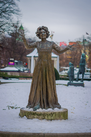 OSLO, NORWAY - MARCH, 26, 2018: Outdoor view of statue of Norwegian actress Wenche Foss in park outside National Theatre Editorial