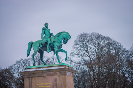 OSLO, NORWAY - MARCH, 26, 2018: Outdoor view of Statue of King Karl Johan outside The Royal Palace in Oslo