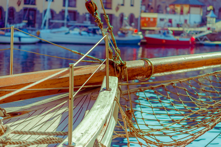 Close up of ropes around mast support boom on boat in port of Alesund in Norway Stock Photo