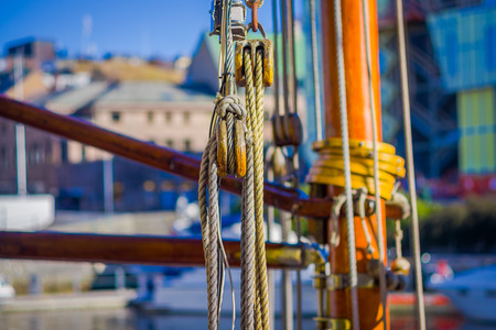 Detail view of ropes on boat in port of Alesund in Norway Stock Photo