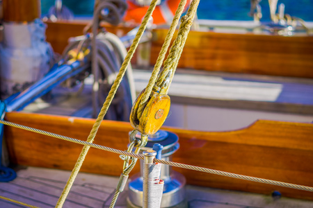 Close up of selective focus of ropes on bottle screws on boat in port of Alesund in Norway