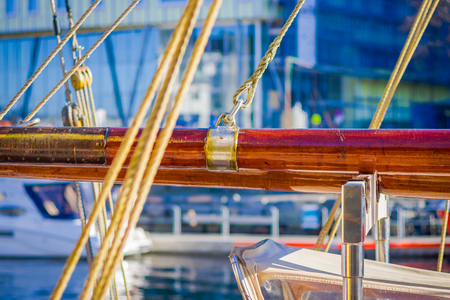 Close up of selective focus of ropes around mast support boom on boat in port of Alesund in Norway, Scandinavia, Europe.