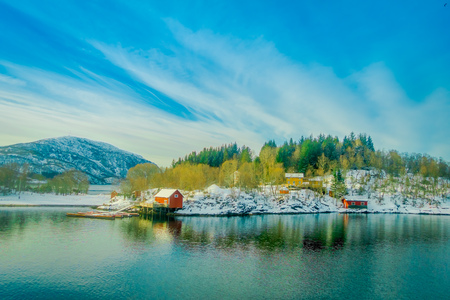 Beautiful outdoor view of wooden houses in a coastal scene on Hurtigruten trip