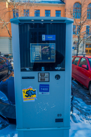 TRONDHEIM, NORWAY - APRIL 09, 2018: Outdoor view of ticket payment machine for parking a vehicle in the street