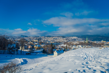 Gorgeous aerial view of the norwegian city with buildings in the horizont in Trondheim during the winter Kho ảnh