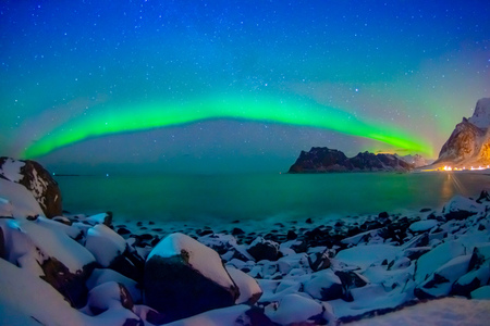 Outdoor view of beautiful multicoloured vibrant Aurora Borealis or Aurora Polaris, also know as Northern Lights in the night sky over Lofoten Islands Stock Photo