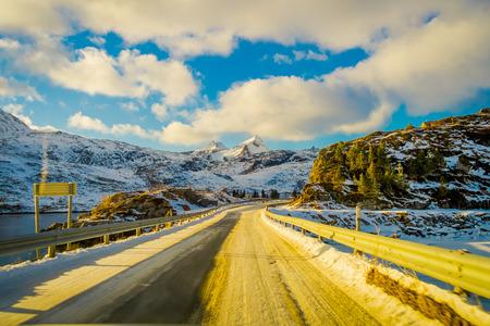 Outdoor view of frozen street in Lofoten Islands in a sunny day