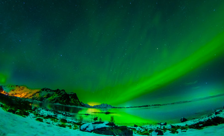 View of Lofoten Islands during winter time is a dream for all landscape photographers. At this time of the year, the colourful and enchanting Aurora Borealis light up the clear night skies