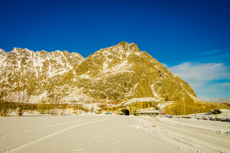 View of frozen street at the enter of a tunnel in Skjelfjord in Lofoten Islands Stock Photo