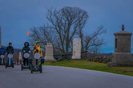 GETTYSBURG, USA - APRIL, 18, 2018: Outdoor view of line of tourists on Segways Seg Tours in Gettysburg National Military Park, in a tour on Cemetery battlefield park