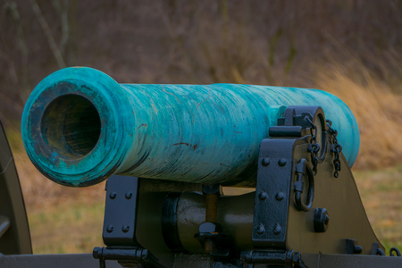 Close up of turquoise cannon of Napoleon, 12 lb located in a cemetery park in Gettysburg National Historical Battlefield