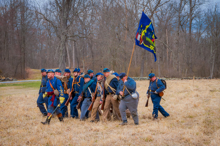 MOORPARK, USA - APRIL, 18, 2018: Unidentified people wearing blue uniform, holding a flag and representing the Civil War Reenactment in Moorpark, the largest battle reenactment Editorial