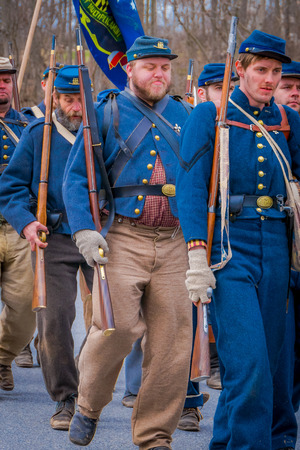 MOORPARK, CA, USA- APRIL 18, 2018: People, wearing Blue uniform during representation of civil War Reenactment in Moorpark, CA is the largest battle reenactment west of the Mississippi
