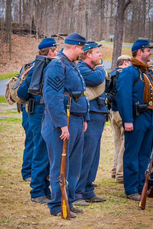 MOORPARK, CA, USA- APRIL 18, 2018: People wearing blue military uniform during Civil War representation Reenactment in Moorpark, is the largest battle reenactment west of the Mississippi