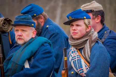 MOORPARK, USA - APRIL, 18, 2018: Close up of group of men wearing blue uniform representing the Civil War Reenactment in Moorpark, the largest battle reenactment Editorial