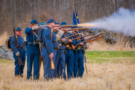 MOORPARK, USA - APRIL, 18, 2018: Group of people wearing uniform and representing the military war reenactment in Moorpark, firing their guns, is the largest battle reenactment west