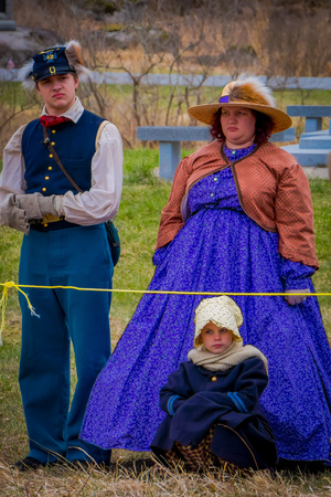 MOORPARK, USA - APRIL, 18, 2018: Outdoor view of people wearing typical clothes of during the Civil War Reenactment in Moorpark, woman with purple dress and man with uniform