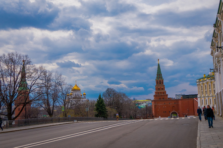 MOSCOW, RUSSIA- APRIL, 29, 2018: Outdoor view of the building of Armoury chamber and the Borovitskaya tower of the Moscow Kremlin
