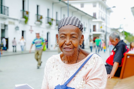POPAYAN, COLOMBIA - FEBRUARY 06, 2018: Portrait of gorgeous colombian black women smiling and looking somewhere, in the streets of Popayan 報道画像