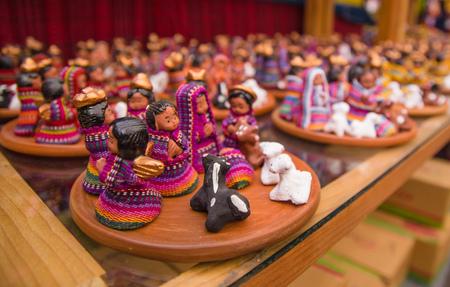 Ciudad de Guatemala, Guatemala, April, 25, 2018: Close up of traditional wooden handicrafts made by Maya people in Antigua