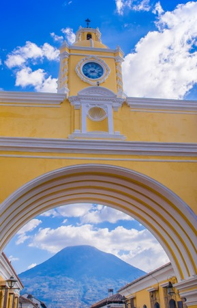 Ciudad de Guatemala, Guatemala, April, 25, 2018: The famous arch of the city center of Antigua together with agua volcano in the horizont, view through the arch Sajtókép