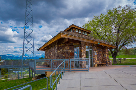 Idaho, USA, May 23, 2018: Beautiful outdoor view of stoned house building located in park with metallic struture viewer to the idaho state, during a gorgeous sunny day and landscape background Sajtókép