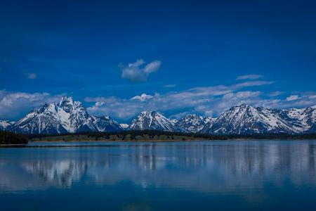 Grand Teton National Park, Wyoming, reflection of mountains on Jackson Lake near Yellowstone Stock Photo