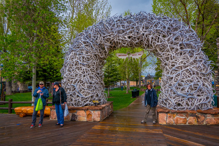 Jackson Hole, USA- May 23 2018: Large elk antler arches curve over Jackson Hole, Wyomings squares, the antlers have been there since the early 1960s, and new arches are assembled to replace them