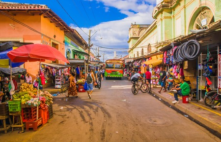 GRANADA, NICARAGUA, MAY, 14, 2018: Unidentified people walking i the street of market stalls at a colorful street in Granada