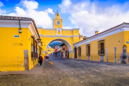 Ciudad de Guatemala, Guatemala, April, 25, 2018: Outdoor view of Santa Catalina arch and the main street of Antigua city at sunny day Editorial