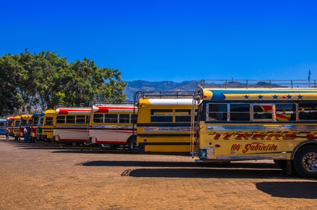 Ciudad de Guatemala, Guatemala, April, 25, 2018: Antigua bus station, with famous chicken bus parked, Antigua is Famous for its Spanish colonial buildings. Sighseeing Place