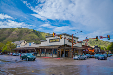 JACKSON HOLE, WYOMING, USA - MAY 23, 2018: Outdoor view of tourists walk on the main city street in Jackson Hole, Wyoming. It has been named after Edward Jackson who trapped beaver in the area