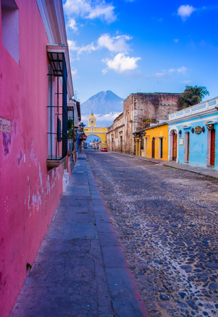 Ciudad de Guatemala, Guatemala, April, 25, 2018: Cityscape in the main street of Antigua city with the Agua volcano in the background Editorial