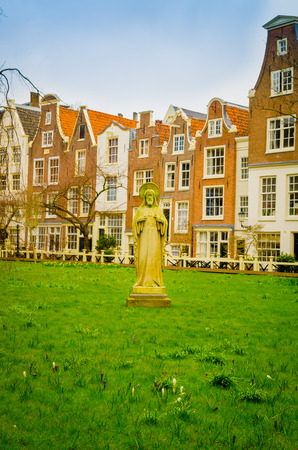 AMSTERDAM, NETHERLANDS, APRIL, 23 2018: Outdoor view of Begijnhof is one of the oldest inner courts in the city of Amsterdam