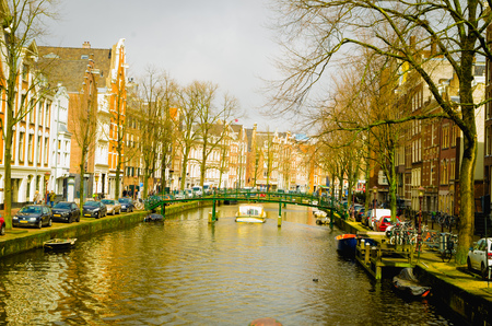 AMSTERDAM, NETHERLANDS, APRIL, 23 2018: Beautiful outdoor view of the canal of Amsterdam, is the capital and most populous city of the Netherlands