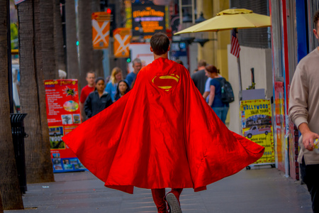 Los Angeles, California, USA, JUNE, 15, 2018: Outdoor view of unidentified man wearing a superman costume and walking in the streets of Los Angeles in Hollywood