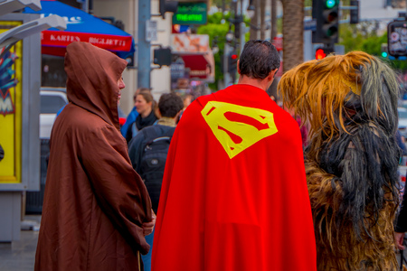Los Angeles, California, USA, JUNE, 15, 2018: Outdoor view of unidentified people wearing different costumes, a superman, chewbacca and jedi in the streets of Los Angeles in Hollywood Stockfoto - 120296439
