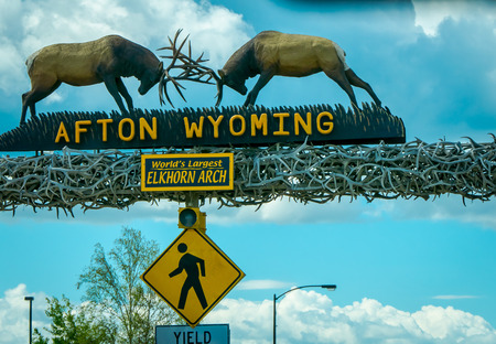 Afton, Wyoming, United States - June 07, 2018: Outdoor view of the worlds larges elkhorn arch at the entrance of the town in a cloudy sky background during a summer season