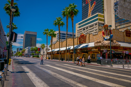 Las Vegas, NV, USA, June 15, 2018: Outdoor view of unidentified people crossing the street in Freemont Boulevard in Las vegas- Nevada. USA Editorial