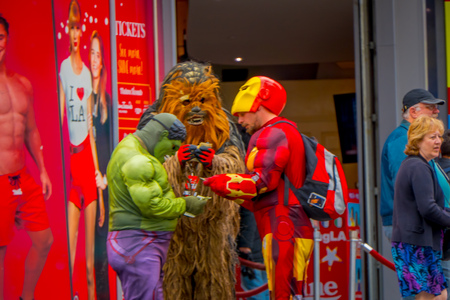 Los Angeles, California, USA, JUNE, 15, 2018: Outdoor view of unidentified people wearing different costumes, chewbacca, hulk and iron man in the streets of Los Angeles in Hollywood