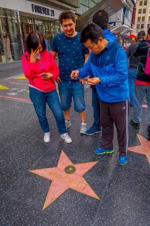 Los Angeles, California, USA, JUNE, 15, 2018: Outdoor view of family taking a picture of a Donald Trump fame star in walk of fame in Los Angeles. Hollywood Walk of Fame features more than 2,500 stars