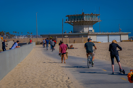 Los Angeles, California, USA, JUNE, 15, 2018: Outdoor view of unidentified people at Venice Beach in Santa Monica, part of Los Angeles is popular by domestic residents for relaxing and sporting