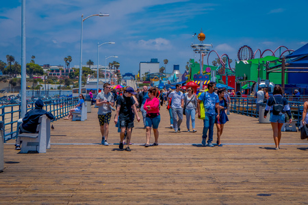 Los Angeles, California, USA, JUNE, 15, 2018: Unidentified people walking in a wooden pier in Santa Monica, at the end of Route 66. The amusement park is a world famous tourist attraction Editorial