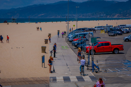 Los Angeles, California, USA, JUNE, 15, 2018: Above view of unidentified people in Santa Monica beach enjoying the summer day and walking path for biking and rolling skating in Los Angeles Editorial